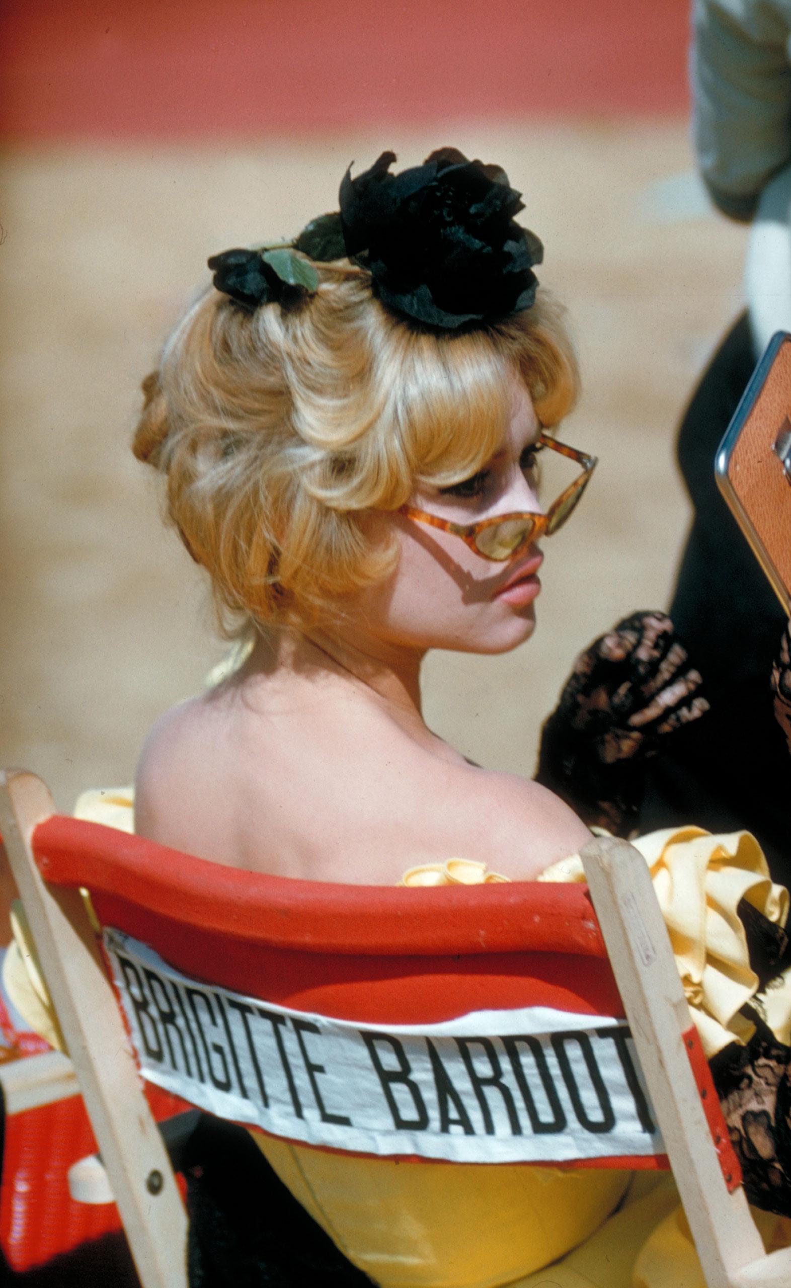 Brigitte Bardot during break on location filming of <i>La Femme et le Pantin</i>, Spain, 1958.