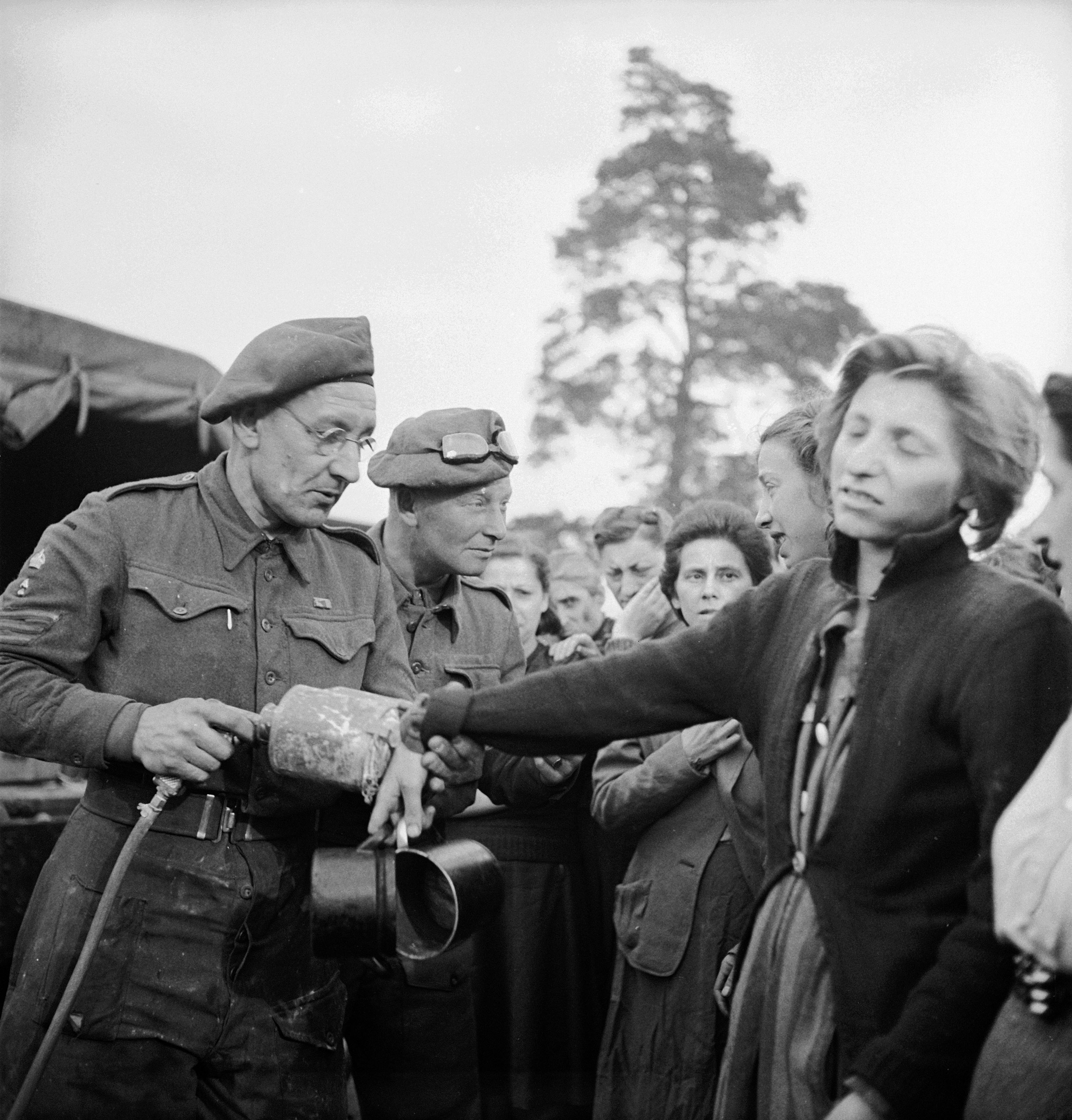 British doctors using DDT to delouse newly liberated prisoners at the Bergen-Belsen concentration cam, 1945.