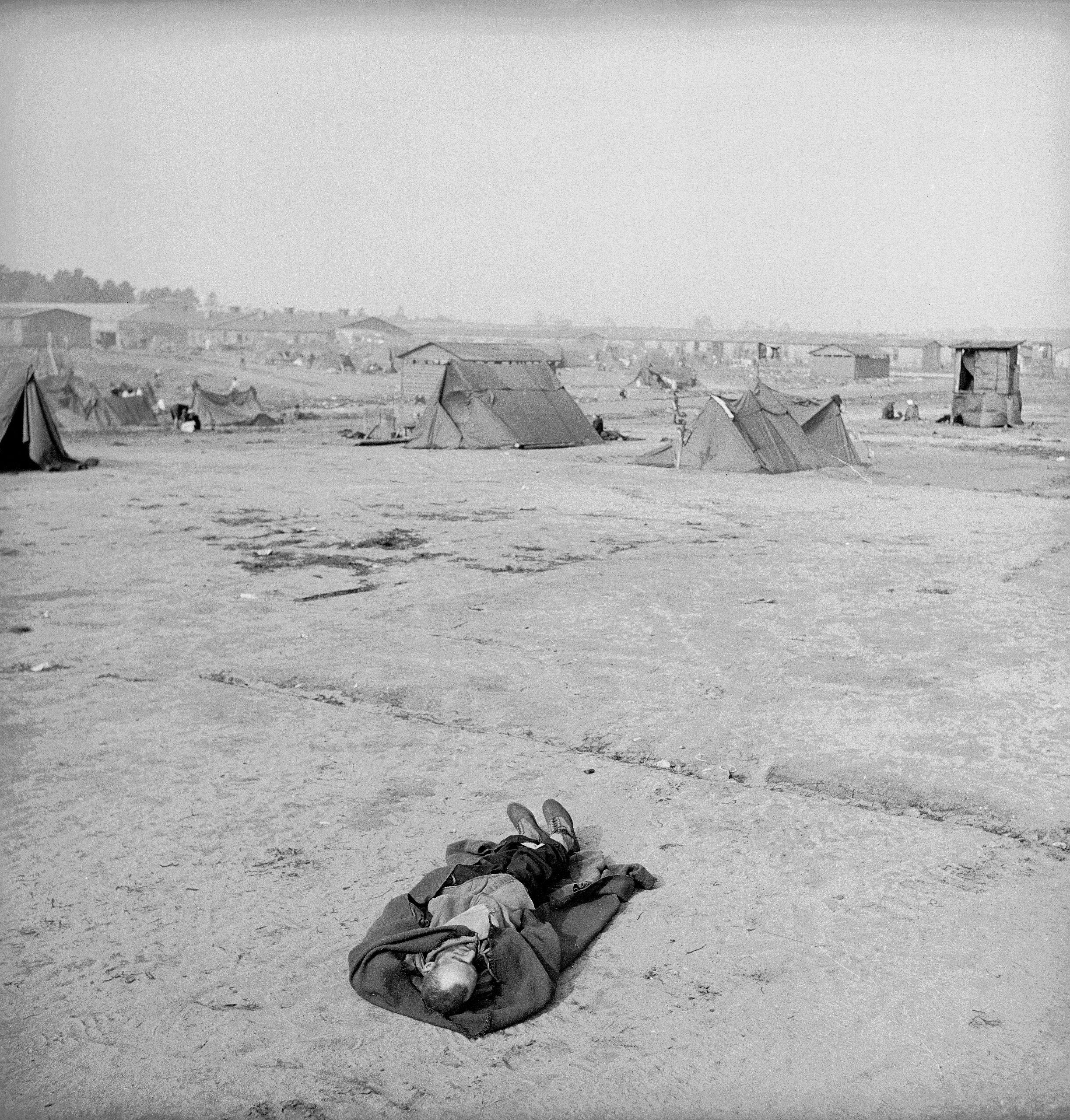 The body of a dead inmate at Bergen-Belsen, photographed shortly after the liberation of the camp by Allied troop, April 1945.