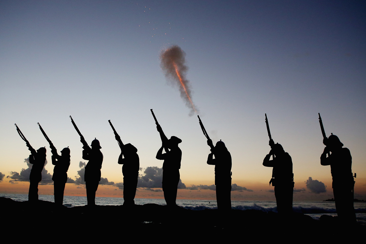 April 25, 2013. Members of the Albert Battery shoot a volley of fire during the ANZAC dawn service at Currumbin Surf Life Saving Club in Gold Coast, Australia.