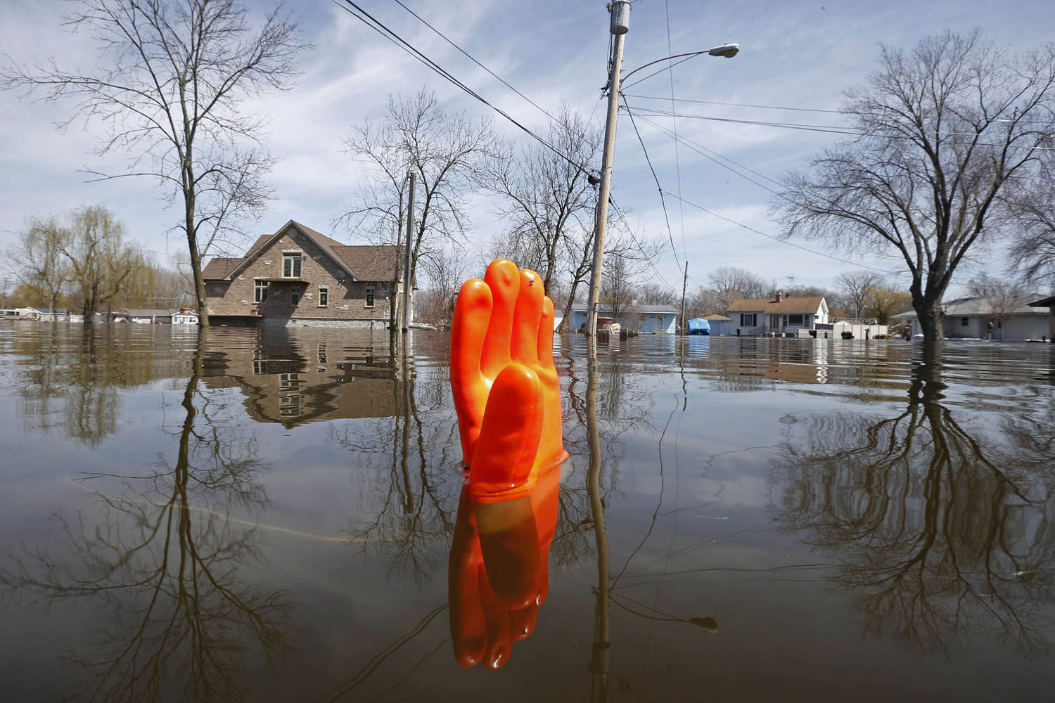 April 22, 2013. A rubber glove being used as a marker bobs in the water after flooding in Fox Lake, Illinois.