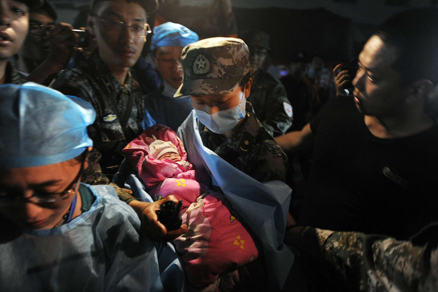 April 22, 2013. A new-born baby which was born in a relief tent is attended by medical staff after an earthquake, which claimed nearly 200 lives, hit Lushan county, Ya'an, Sichuan province.