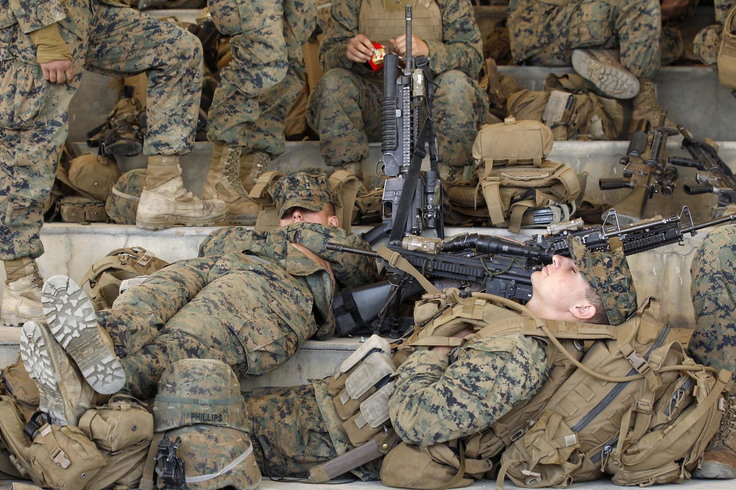 April 22, 2013. U.S. Marines take a rest during the Combined Joint Logistics Over the Shore exercise as part of the two-month-long Foal Eagle series of U.S.-South Korea joint and combined field training exercises on Pohang beach, southeast of Seoul, South Korea.