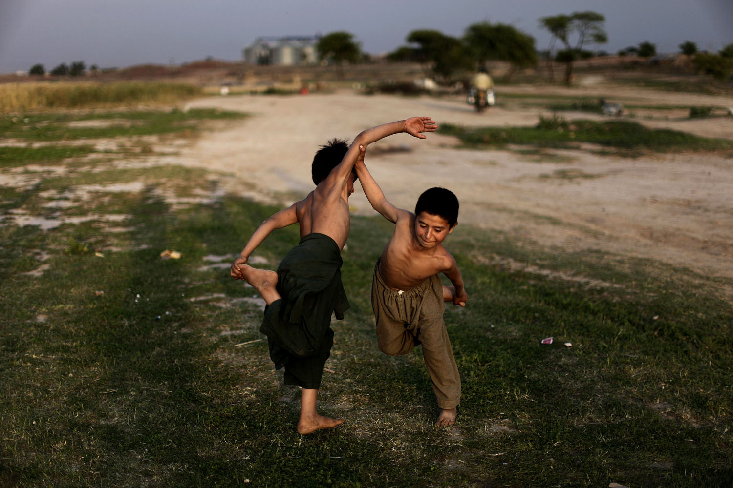 April 22, 2013. Afghan refugee boys play a traditional fighting game on the outskirts of Islamabad.