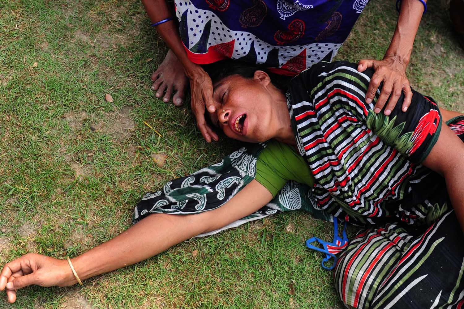 April 25, 2013.                               A Bangladeshi woman reacts after identifying the body of her husband killed in the collape of an eight-storey building in Savar, on the outskirts of Dhaka.