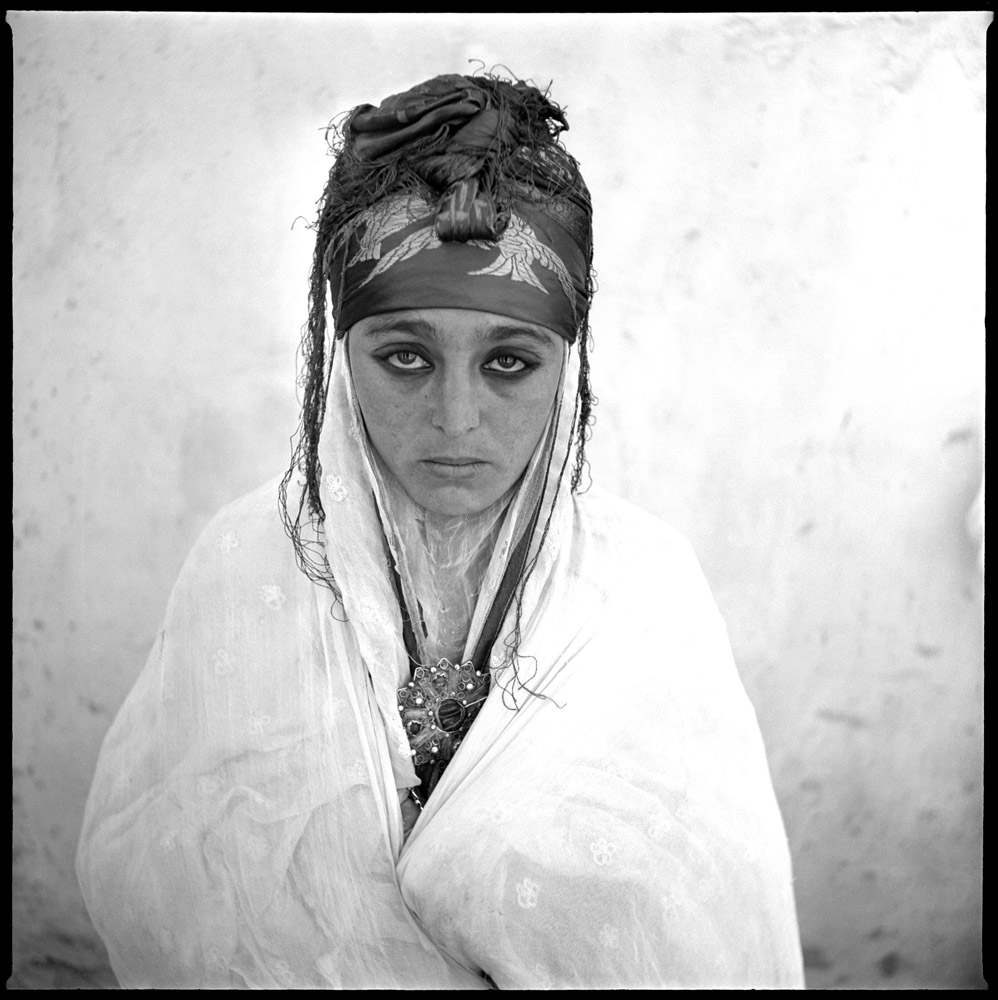 A 1960 photograph of an Algerian woman in a French regroupment village.