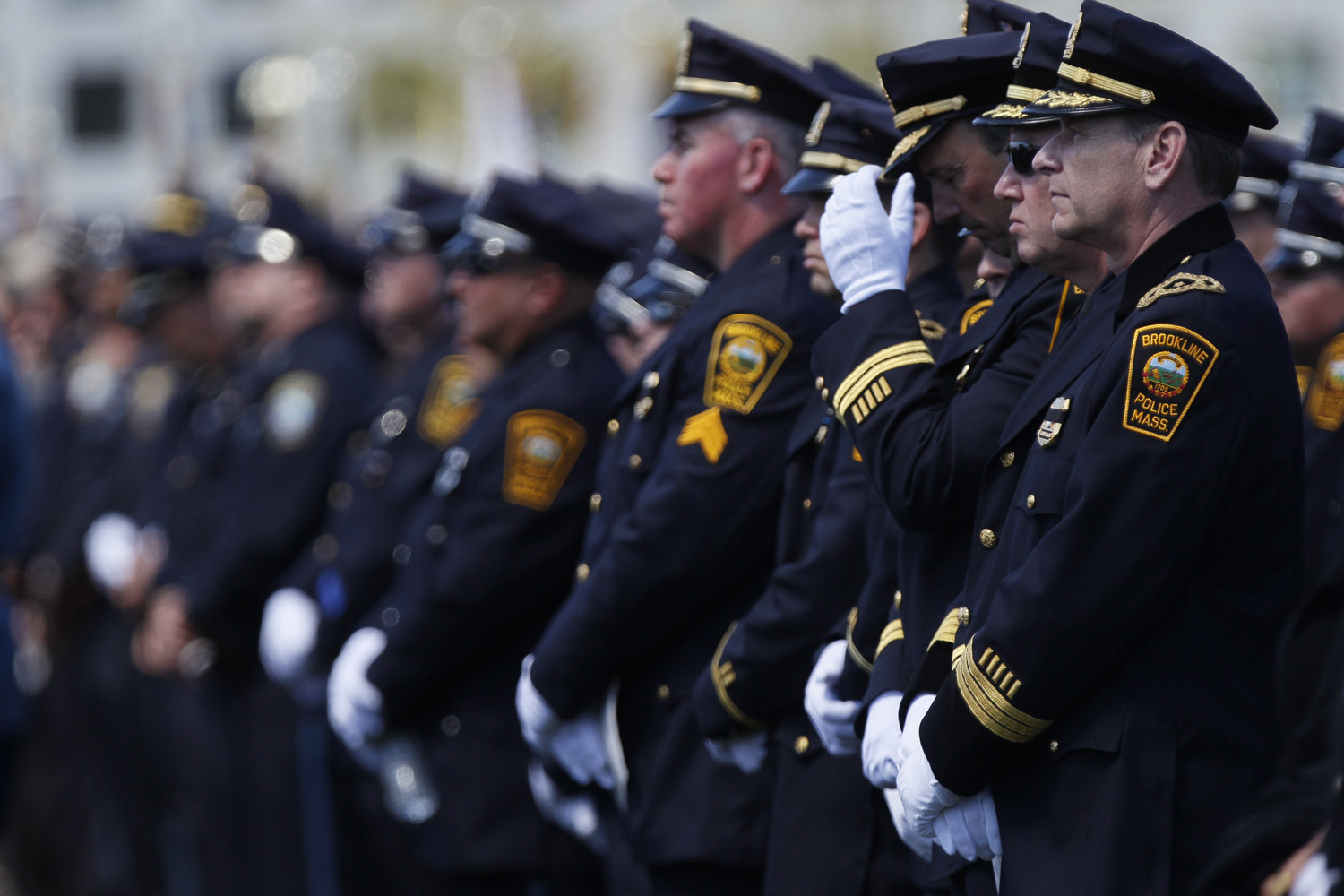 April 23, 2013. Law enforcement officers during a memorial service for Massachusetts Institute of Technology police officer Sean Collier, at Briggs Field on the university's campus in Cambridge, Mass.