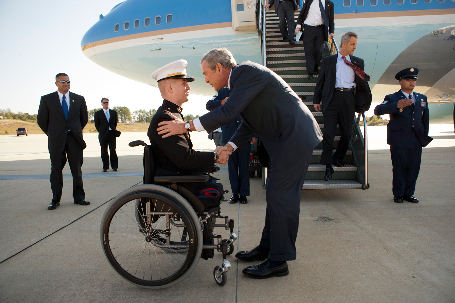Nov. 2, 2007. President Bush greets Marine Corps Lieutenant Andrew Kinard, a twenty-four-year-old from Spartanburg, South Carolina, after arriving at Columbia Metropolitan Airport. Lieutenant Kinard was wounded in 2006 while serving in Iraq.