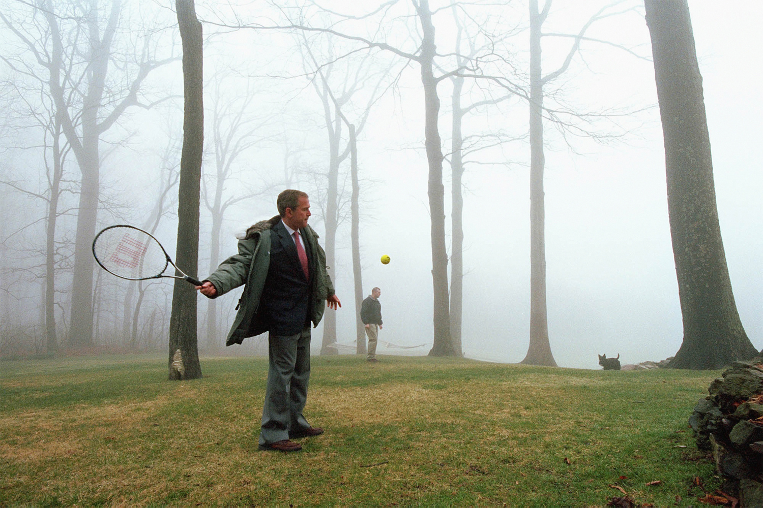 April 8, 2001. The president smacks a tennis ball towards Barney, his Scottish Terrier, during his first visit to Camp David as president.