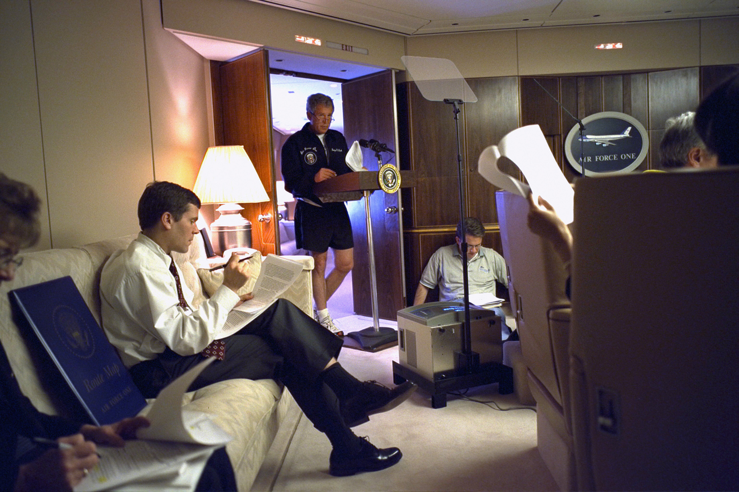 May 30, 2003. President Bush rehearses a speech as he works with staff in the conference room of Air Force One en route to Krakow, Poland.