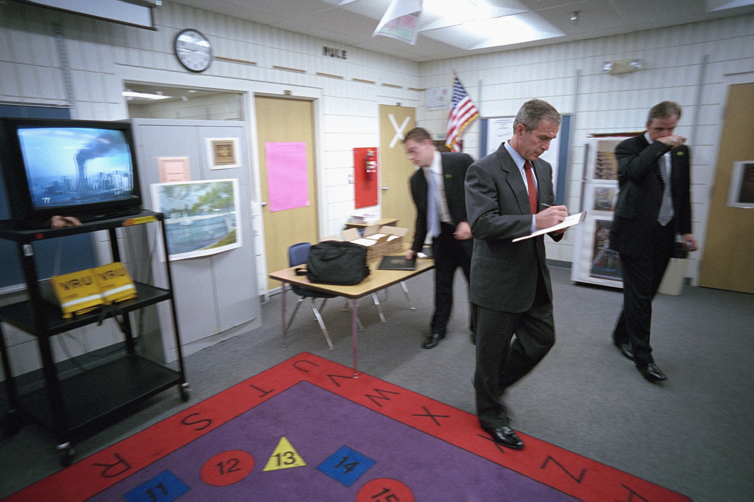 Sept. 11, 2001. From a classroom at Emma Booker Elementary School, President Bush takes notes as he listens to news coverage of the World Trade Center terrorist attacks.
