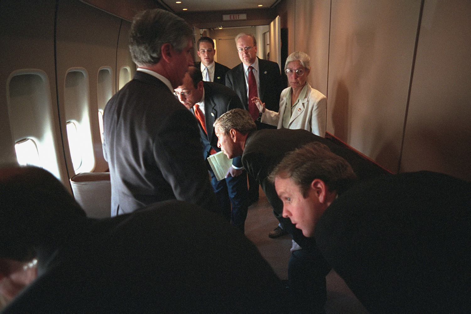 Sept. 11, 2001. President Bush and his staff look out the windows at their F-16 excort while en route to Barksdale Air Force Base. Pictured with the president are, from left to right, White House Cheif of Staff Andy Card, Press Secretary Ari Fleischer, personal assistant Blake Gottesman, Senior Advisor Karl Rove, Director of White House Situation Room Captain Deborah Loewer, and Deputy Assistant Dan Bartlett.