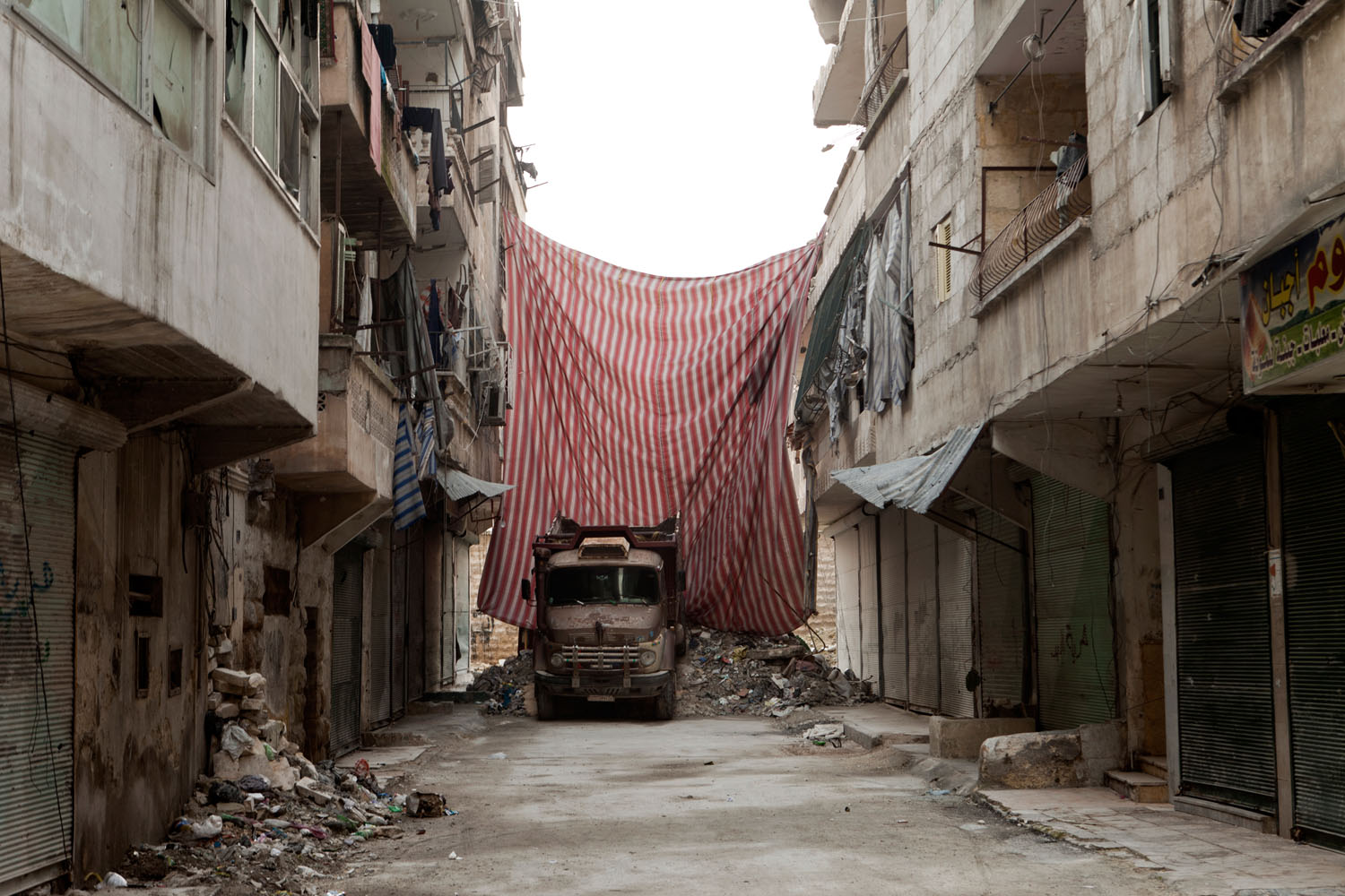 Pagetti says the curtains reminded him of the miles upon miles of concrete barriers that crisscrossed Baghdad during the worst of the sectarian violence there, in 2006 and 2007.
