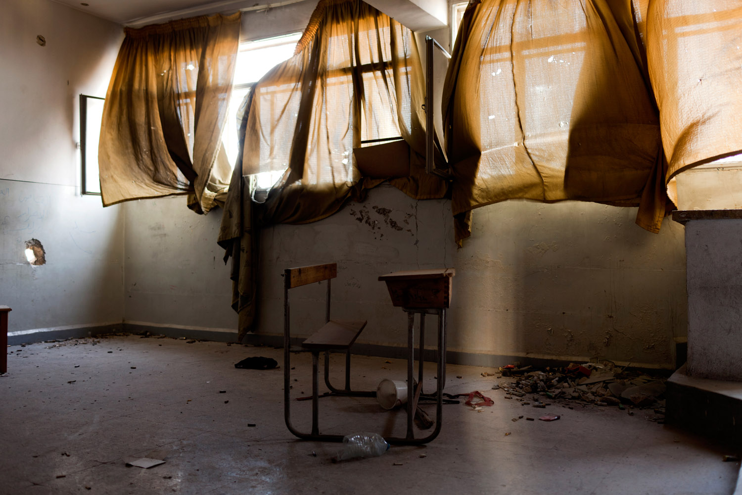 An abandoned classroom, now a Free Syrian Army sniper position, in Aleppo.