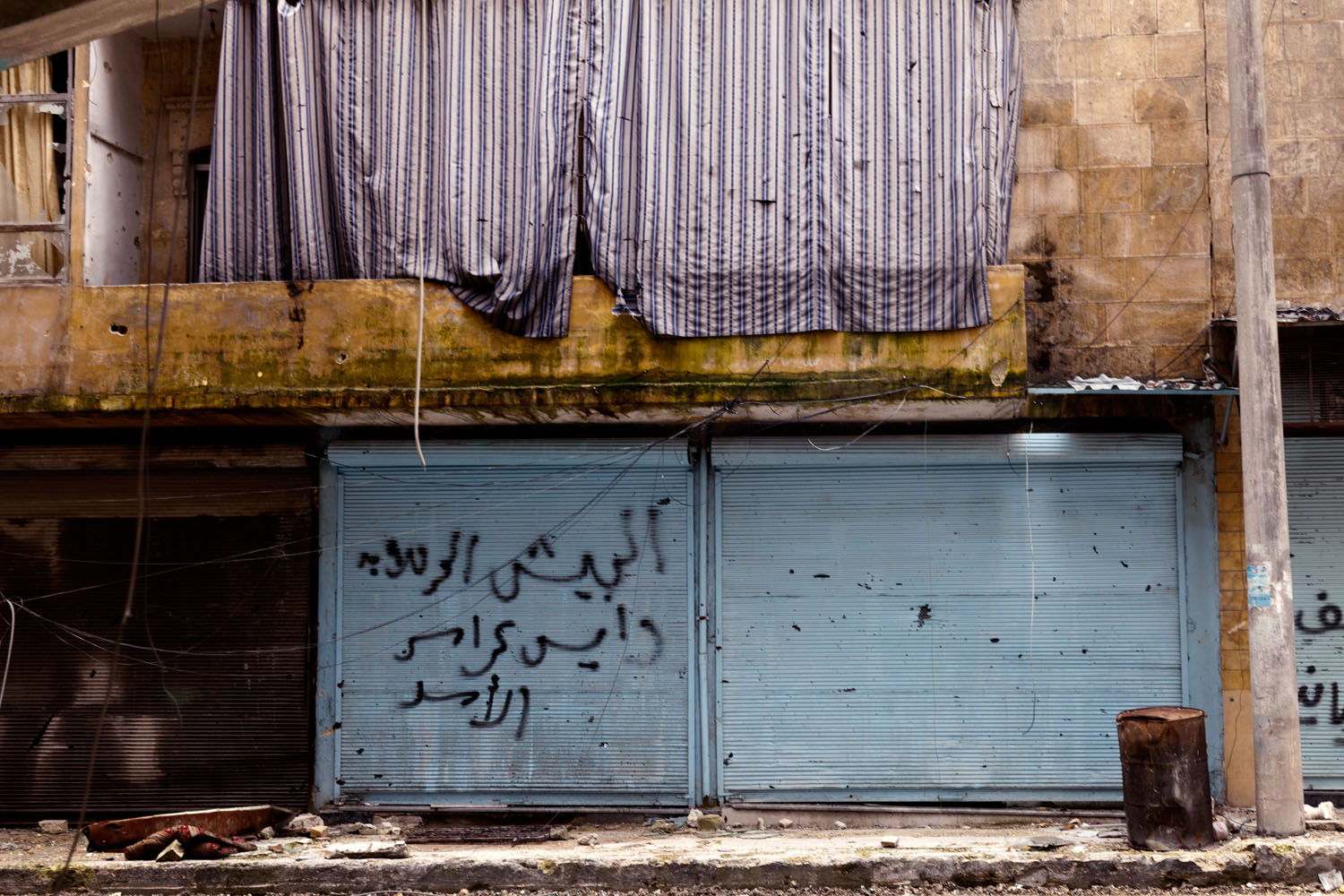 An abandoned storefront in Aleppo.