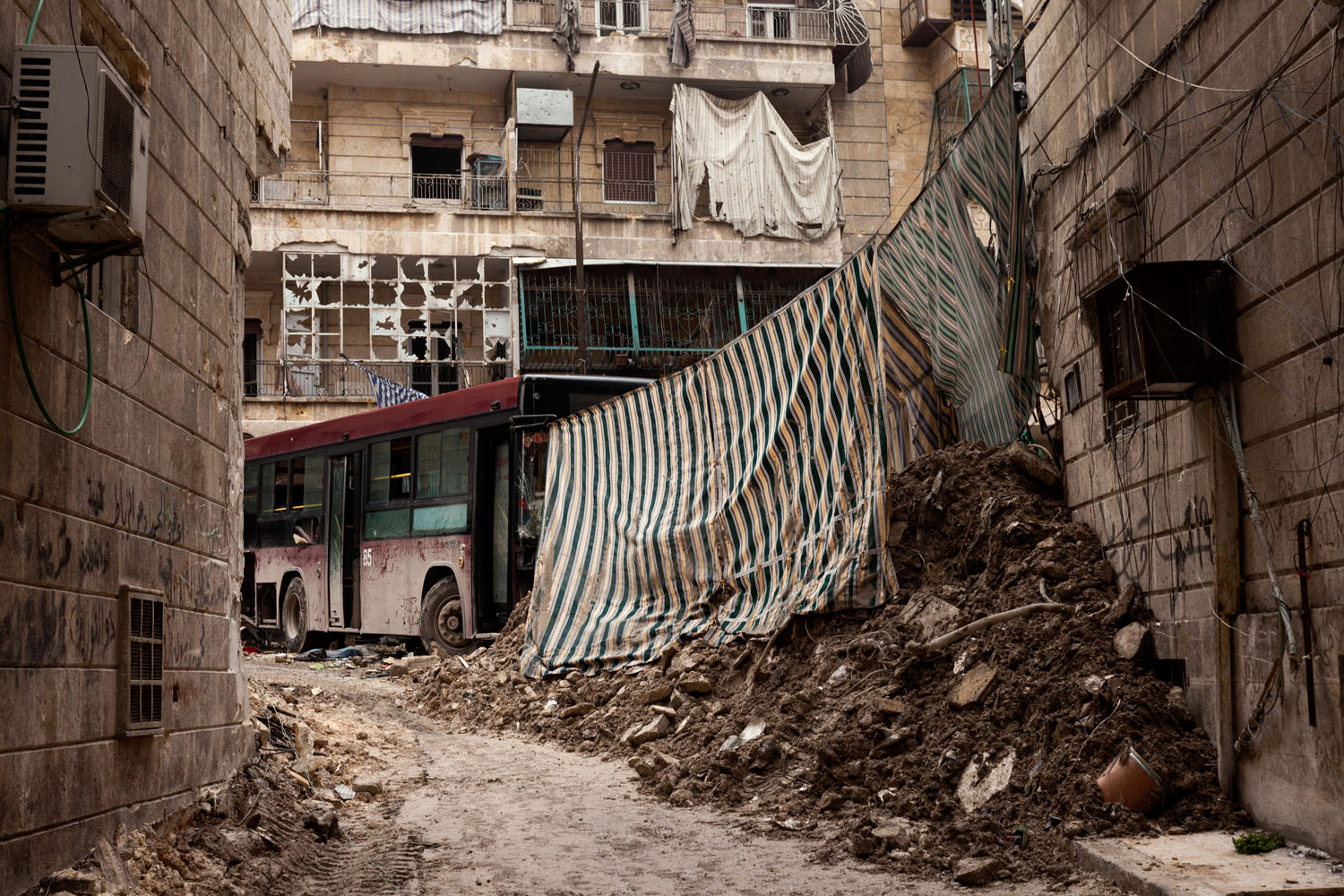 """""""Aleppo's sheets serve the same purpose: they protect lives,"""" the photographer, Franco Pagetti, says. """"But you're always aware how fragile they are."""