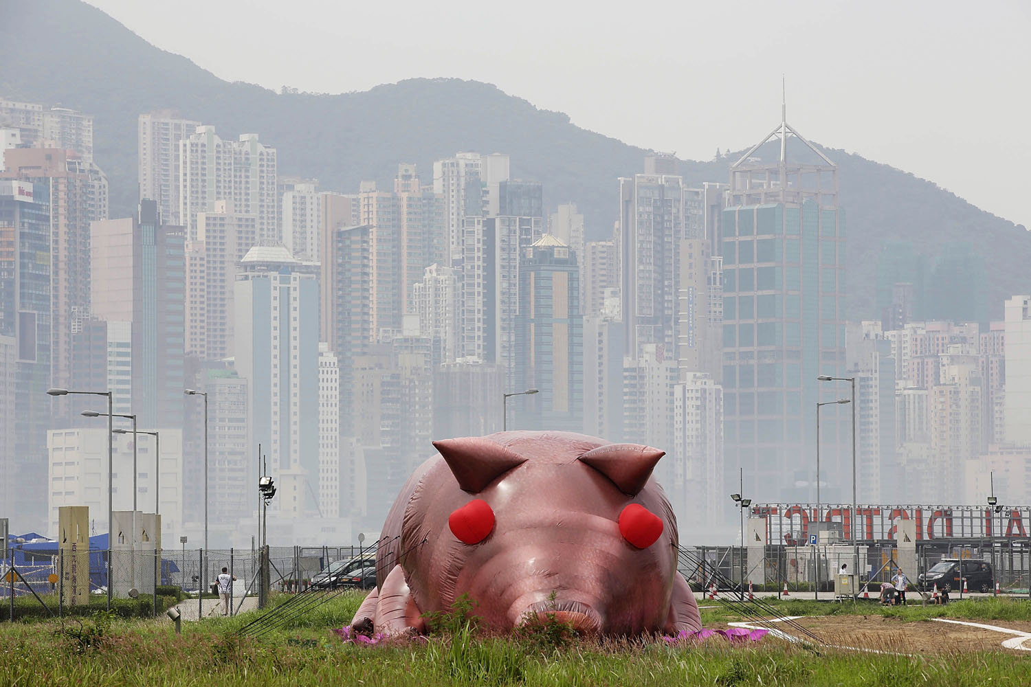 April 24, 2013. An inflatable sculpture of a pig called 'House of Treasures' by Chinese contemporary artist Cao Fei on display as part of the 'Inflation!' exhibition curated by Mobile M + in Hong Kong.