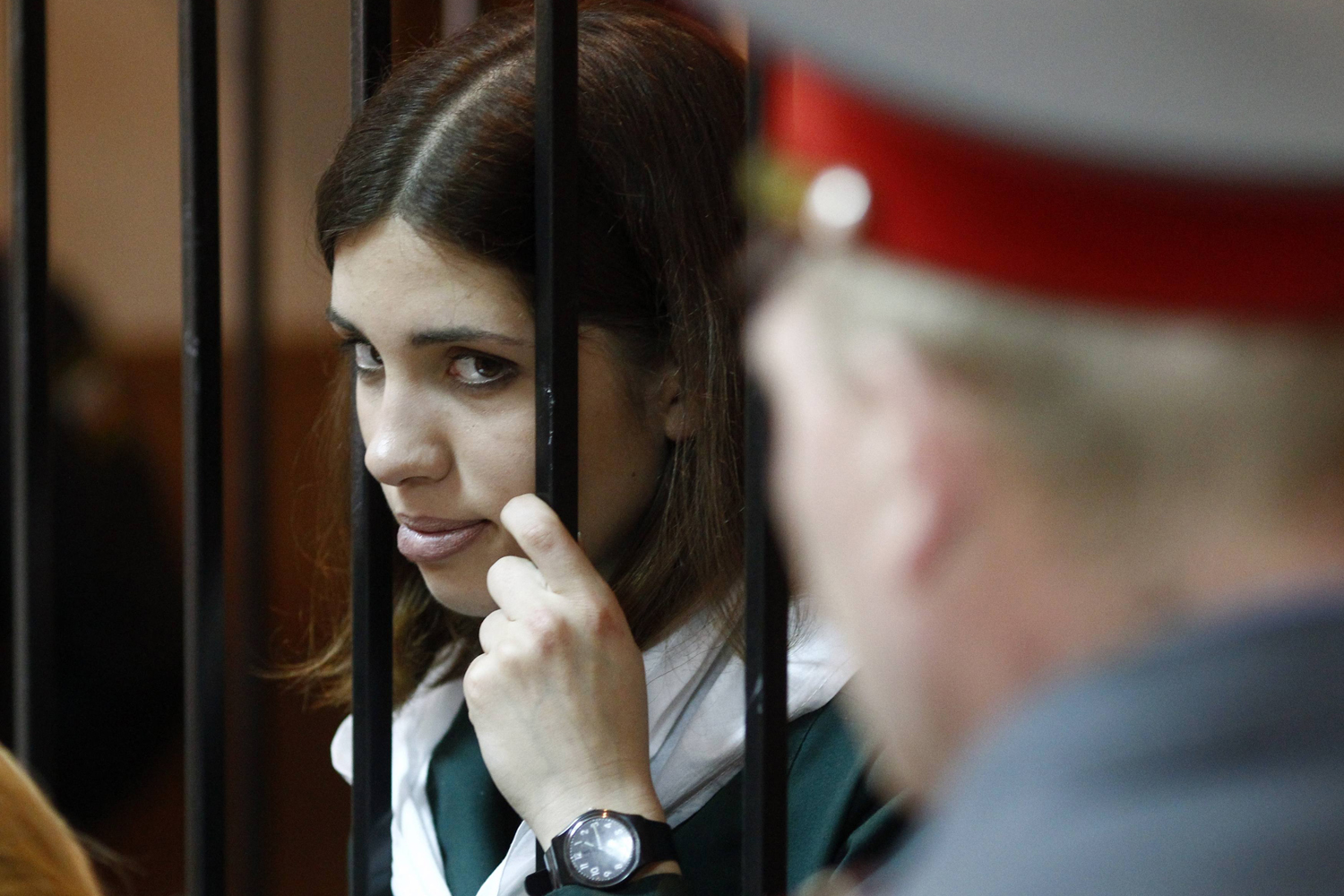 April 26, 2013. Pussy Riot band member Nadia Tolokonnikova looks out from a holding cell during a court hearing in the town of Zubova Polyana.