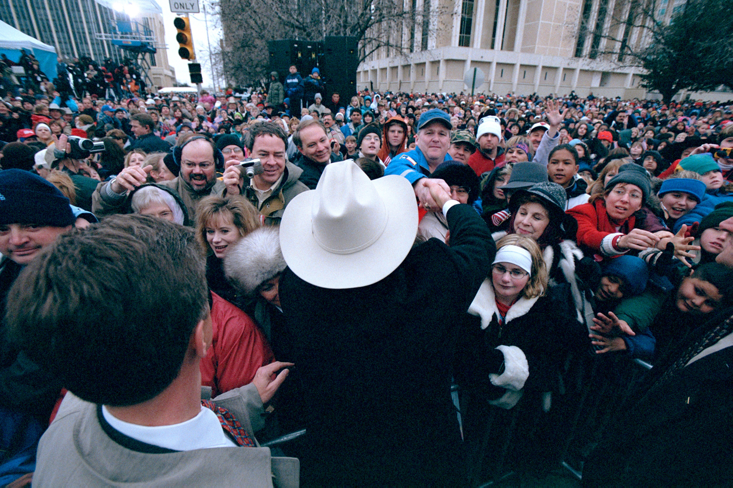 Jan. 17, 2001. President Elect George W. Bush greets and audience of friends and family in downtown Midland during a send-off rally before leaving for Washington D.C.