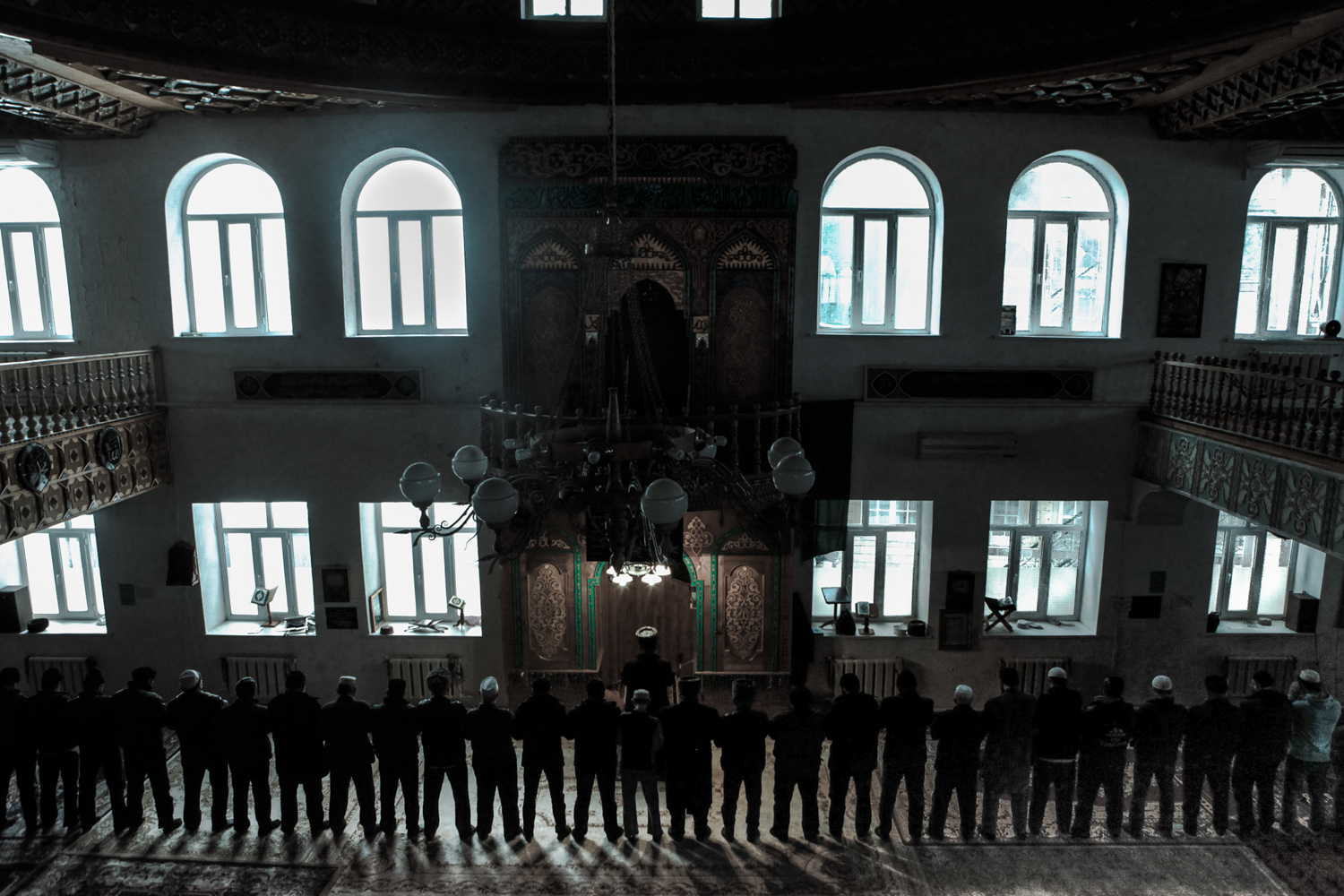 Men praying in mosque.