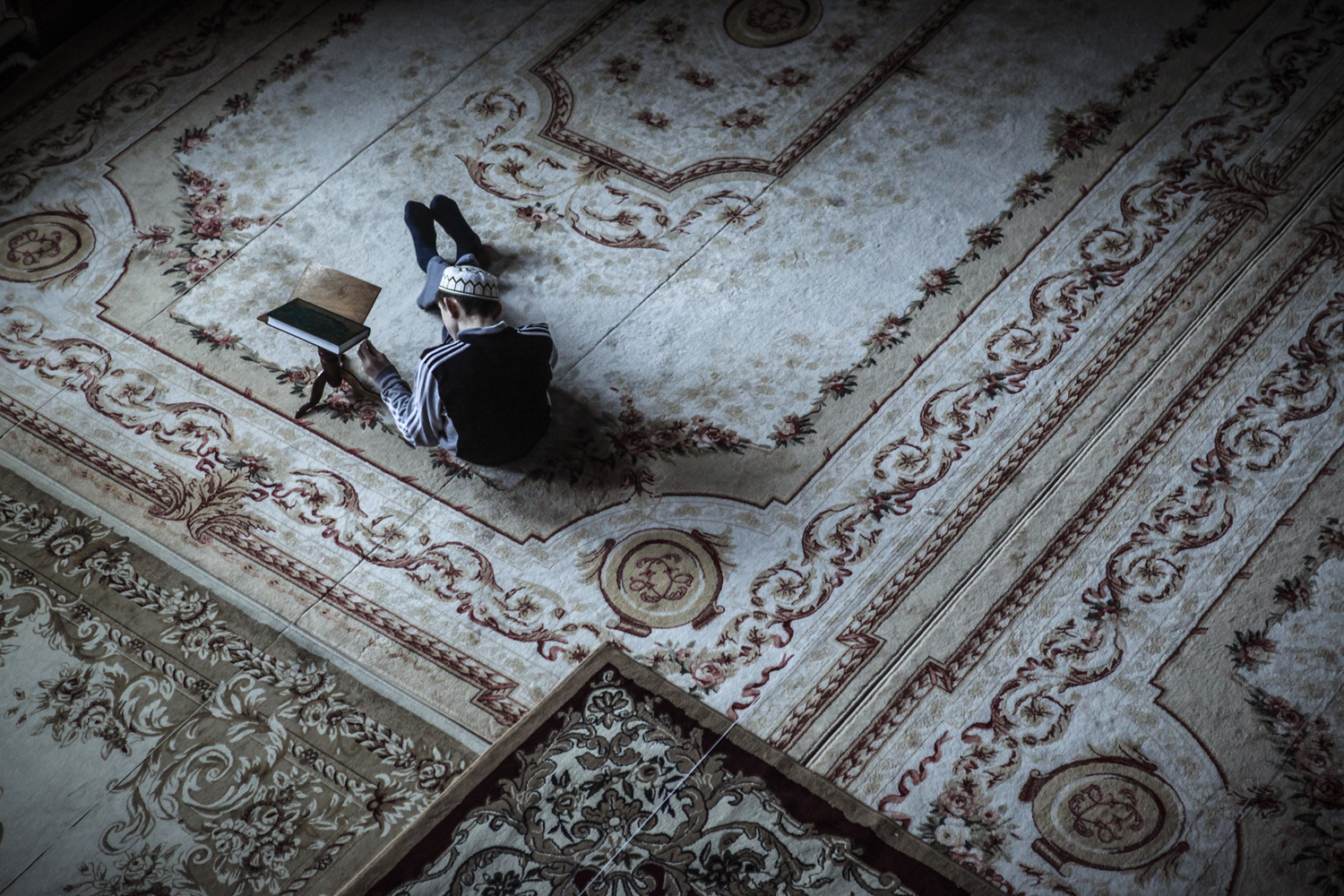 A boy studying Koran in a mosque in Makhachkala.