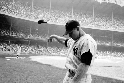 Mickey Mantle flings his batting helmet in disgust after a lousy at-bat, Yankee Stadium, 1965.