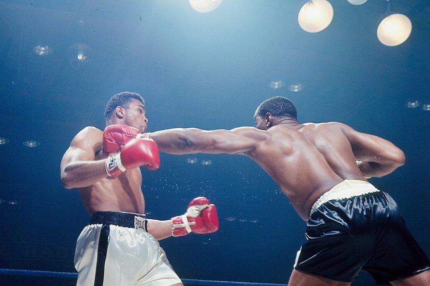 Muhammad Ali dodges a Sonny Liston left jab, Lewiston, Maine, May 25, 1965.