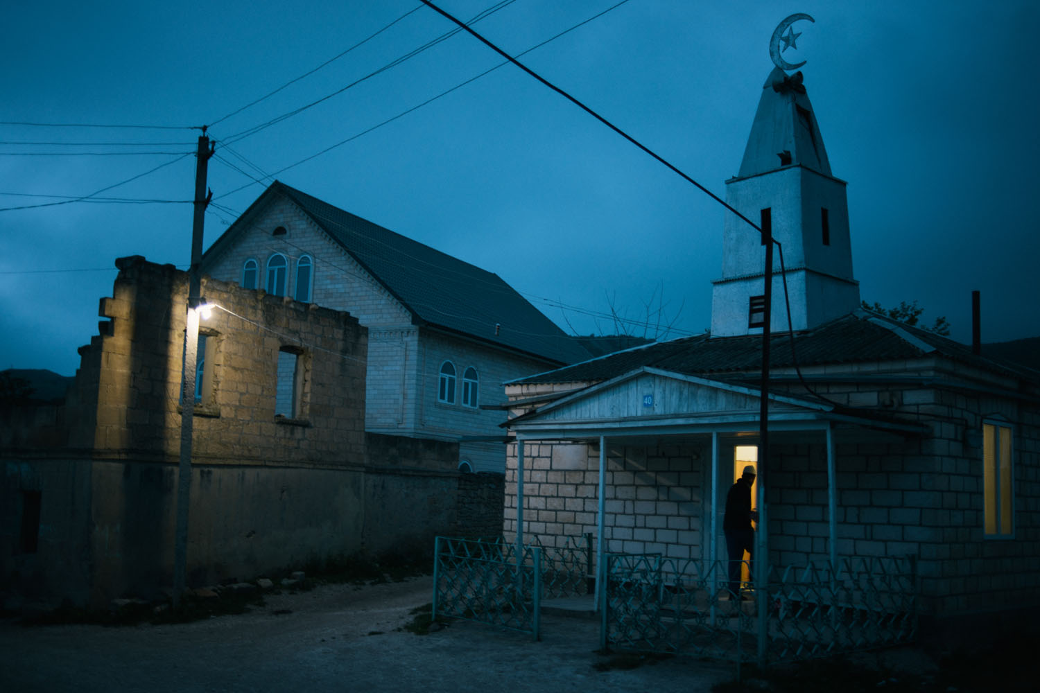 The following photographs were taken between May 12-15, 2013.                               A man arrives at                               the village mosque in Utamysh, the home of Russian-born Canadian William Plotnikov, who was killed in a shootout with Russian counterterrorism forces in July 2012.