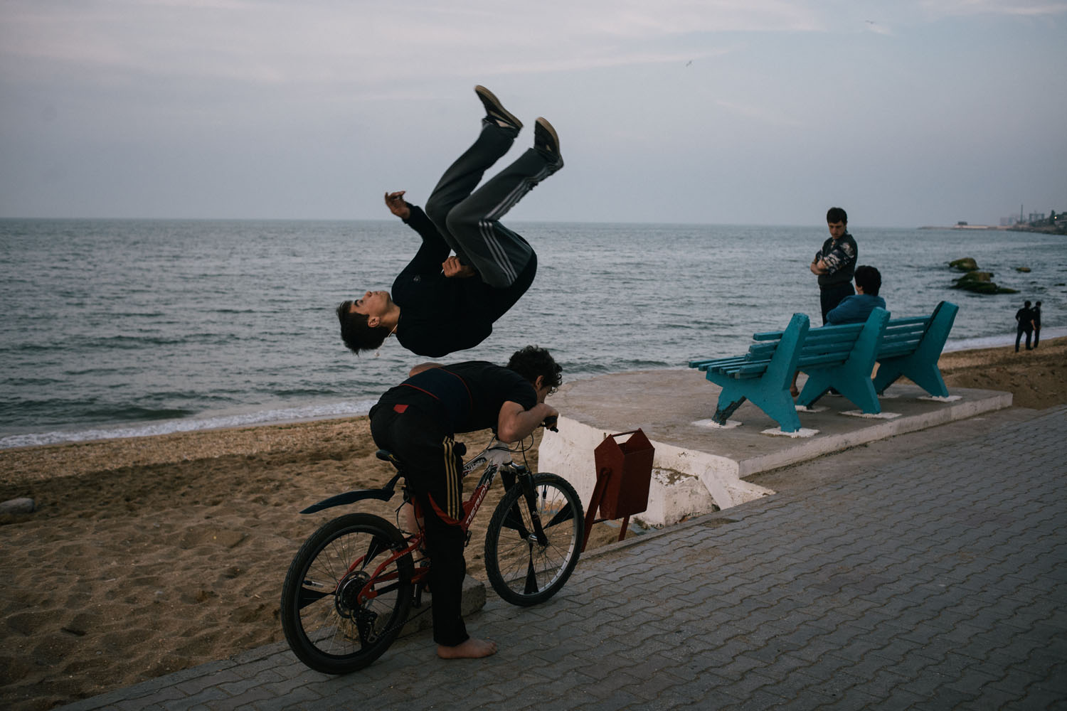 Young boys perform parkour on the beach in Makhachkala.