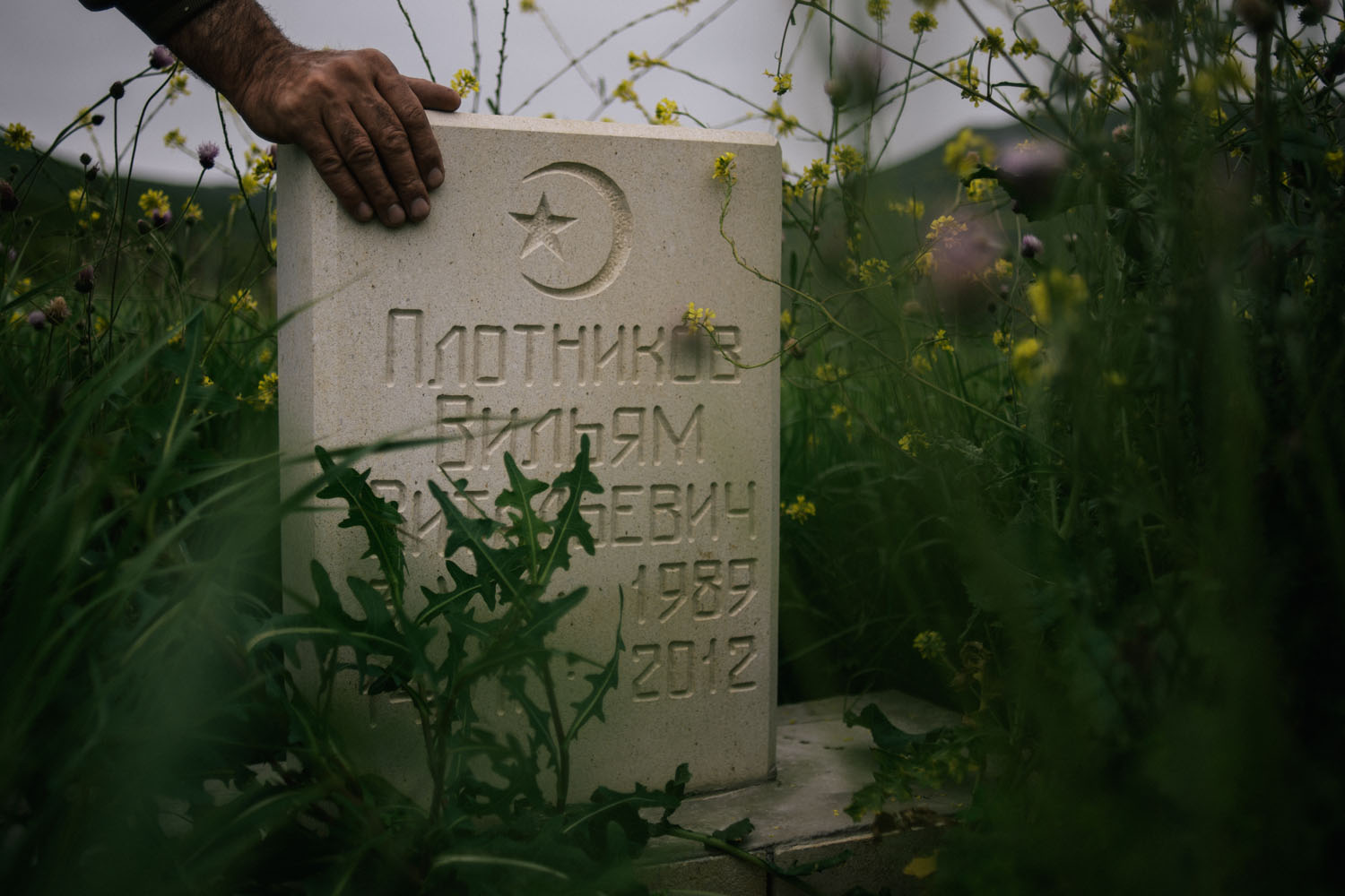 The grave of William Plotnikov, who was killed in a shootout with Russian counterterrorism forces in July 2012.