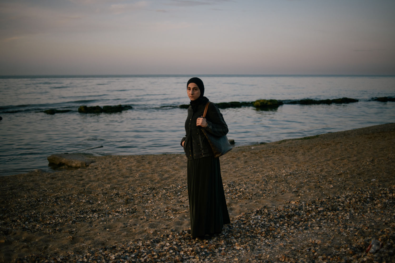The mother of the two Boston bombing suspects, Zubeidat Tsarnaeva, walks near the Caspian Sea.