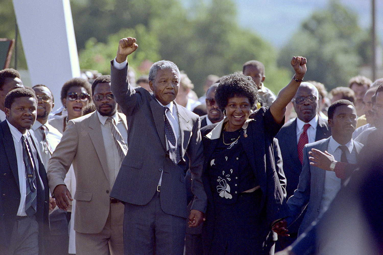 The world looked on as international hero Mandela walked out of prison after 27 years on Feb. 11, 1990, with his wife, Winnie. At 6'3  tall,  Madiba  and his presence met the stature that the world had expected.