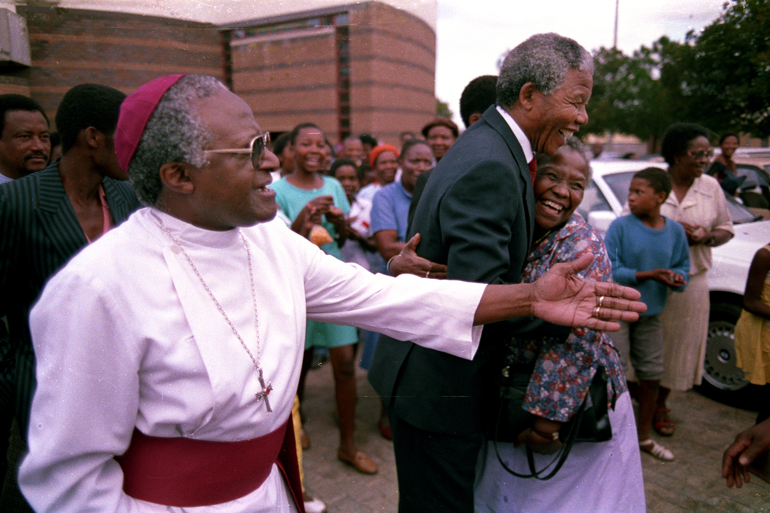 Archbishop Desmond Tutu leads Mandela through the neighborhood in Soweto where Mandela lived before going to prison — the same neighborhood home to Archbishop Tutu — on the first day of his release from prison.