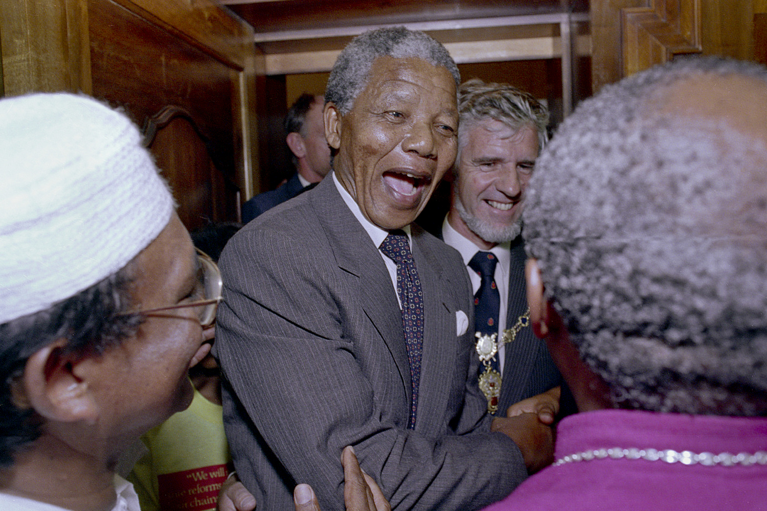 Mandela is greeted by Archbishop Desmond Tutu at the Cape Town City Hall, among the first group of people that Mandela celebrated with after his release.