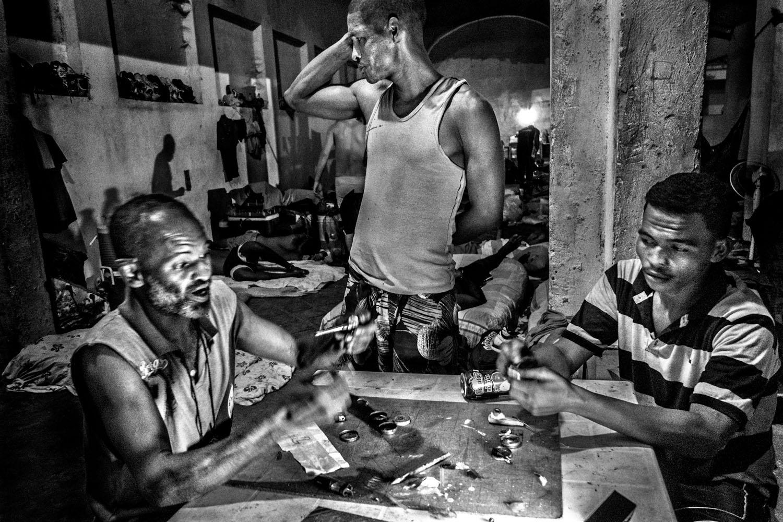 Prisoners preparing pipes used to smoke crack cocaine.