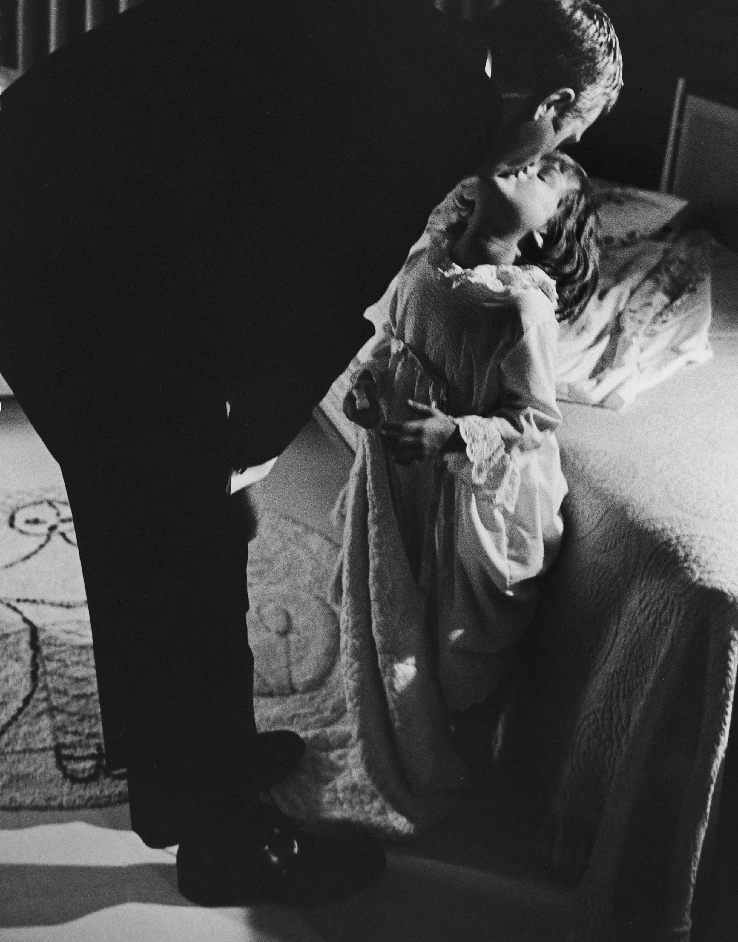 Steve McQueen kisses his daughter Terry goodnight in 1963.