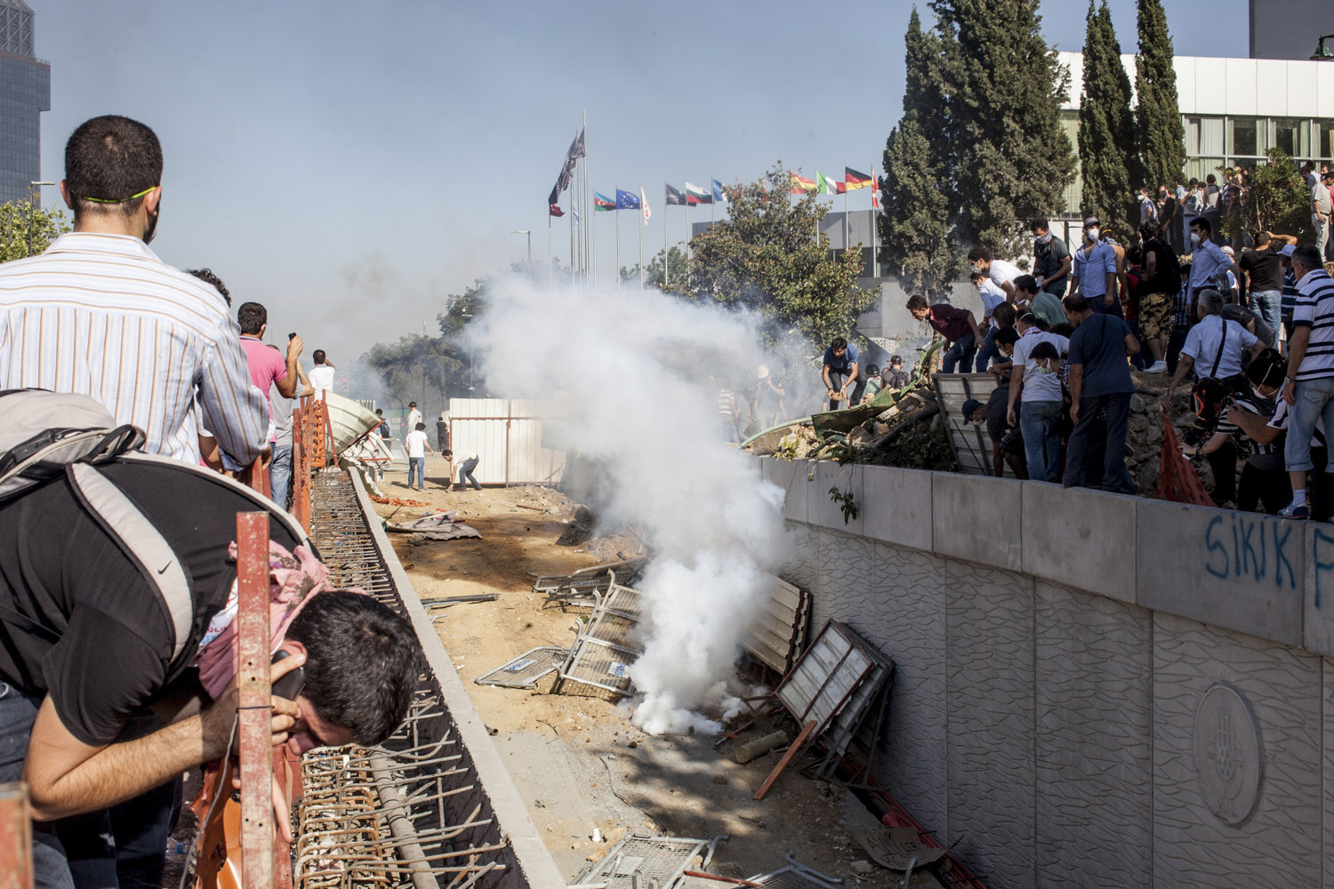 A tear gas round lands in the construction site of  the propsed mall, mosque and shopping complex in the Gezi Park area of Istanbul as thousands of protesters attempt to get to the area.