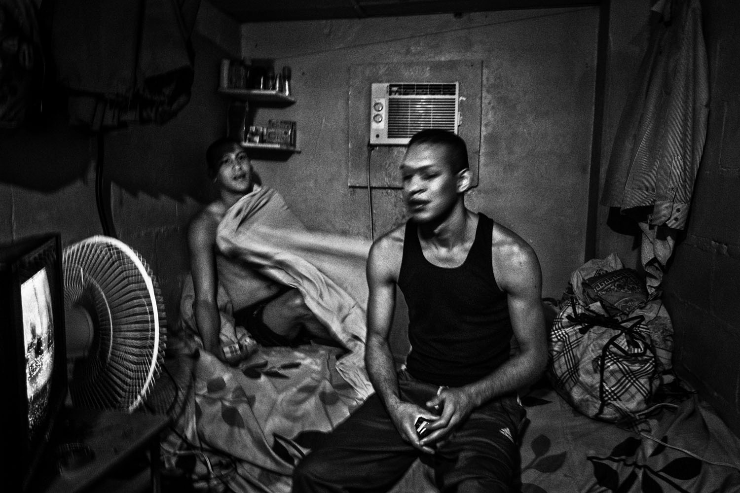 A small cell houses two brothers, with beds, a roof, air conditioning and a television. Such amenities are made available because they have made payments to the leaders of the prison, about $10 each.