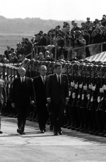 President John F. Kennedy (right) walks past German armed forces during his June 1963 visit to Germany.
