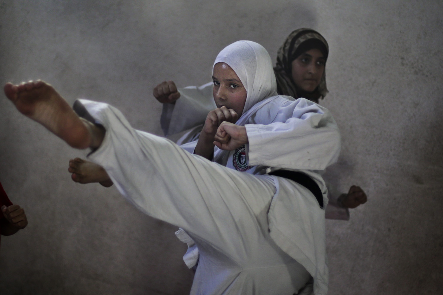 June 1, 2013. Palestinian girls attend a Karate class at a Gaza sports club in the Gaza Strip.