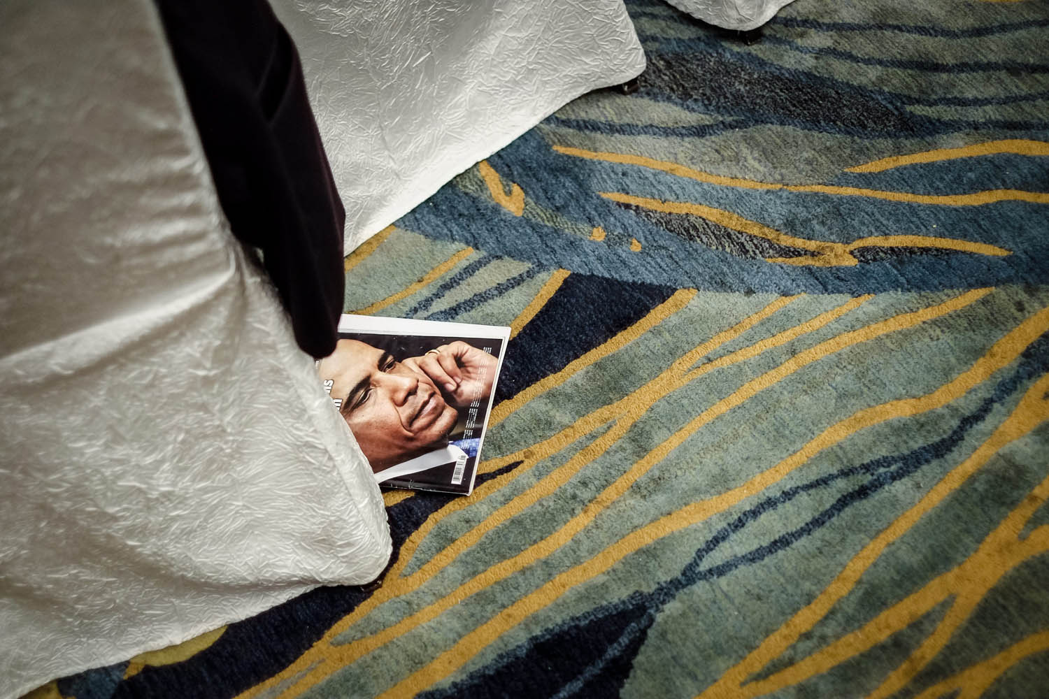June 2, 2013. A magazine with a picture of US President Barack Obama pokes out from underneath a delegate's chair during a plenary session on the third day of The International Institute for Strategic Studies (IISS) 12th Asia Security Summit in central Singapore.
