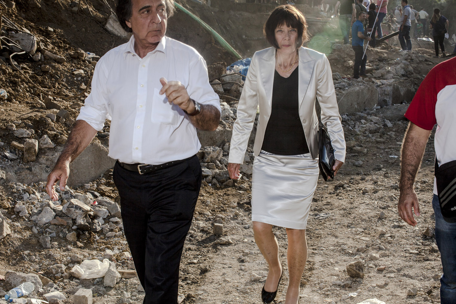 A couple walks amongst the rubble of the Gezi Park construction area after anti-government protesters drove back riot police.