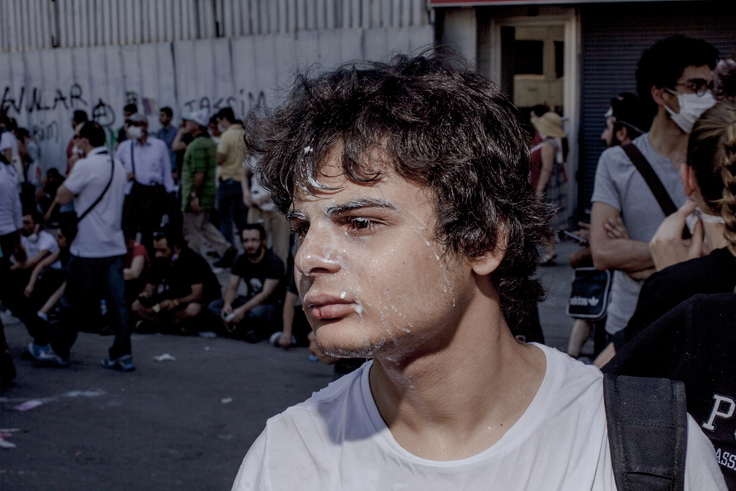 A young protester recovers from the effects of tear gas fired by Istanbul police in the middle class district of Sisli.