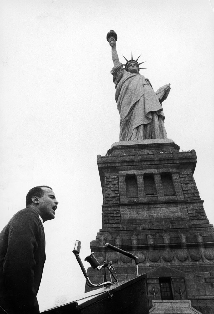 Harry Belafonte speaks at a civil rights rally at the Statue of Liberty, 1960.