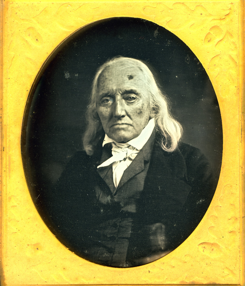 Peter Mackintosh, daguerreotype.                                                              Peter Mackintosh was a 16-year-old apprentice blacksmith in Boston working in the shop of his master, Richard Gridley, the night of December 16, 1773 when a group of young men rushed into the shop, grabbed ashes from the hearth and rubbed them on their faces. They were among those running to Griffin's Wharf to throw tea into the harbor as part of the Boston Tea Party that started the Revolution. Mackintosh later served in the Continental Artillery as an artificer, a craftsman attached to the army who shoed horses and repaired cannons, including one mortar whose repair General George Washington oversaw personally.  During his last years, Mackintosh and his lawyers fought for the pension he deserved. The government awarded it to his family only after his death, which was on November 23, 1846 at age 89.