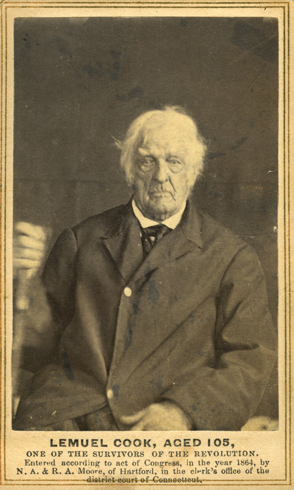 """Lemuel Cook, CDV card photo.                                                              Lemuel Cook witnessed the British surrender at Yorktown, the event that guaranteed American independence. Of the event, he said, """"Washington ordered that there should be no laughing at the British; said it was bad enough to surrender without being insulted. The army came out with guns clubbed on their backs. They were paraded on a great smooth lot, and there they stacked their arms."""""""