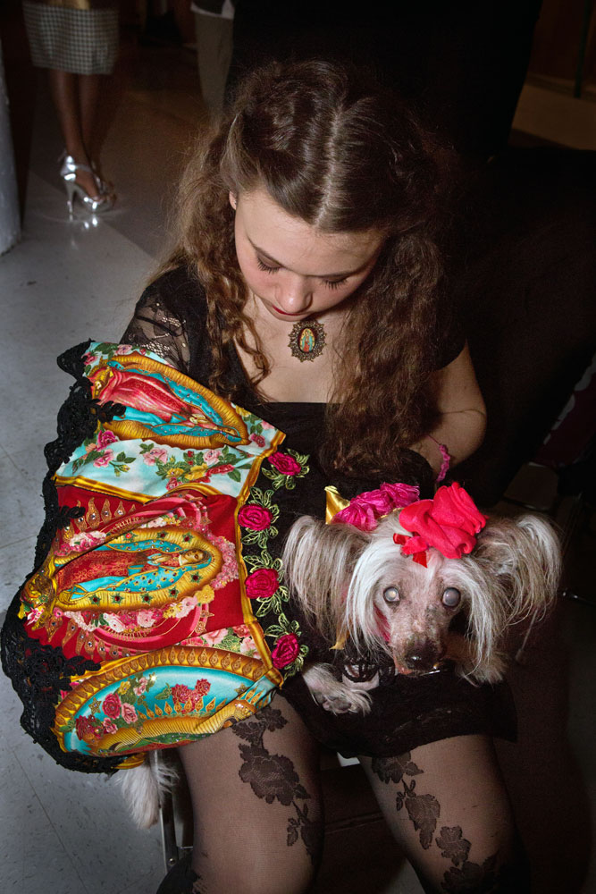Amelia Forman and Nora, a Chinese Crested, wait backstage at Anthony Rubio's fashion show during Brooklyn Fashion Week.