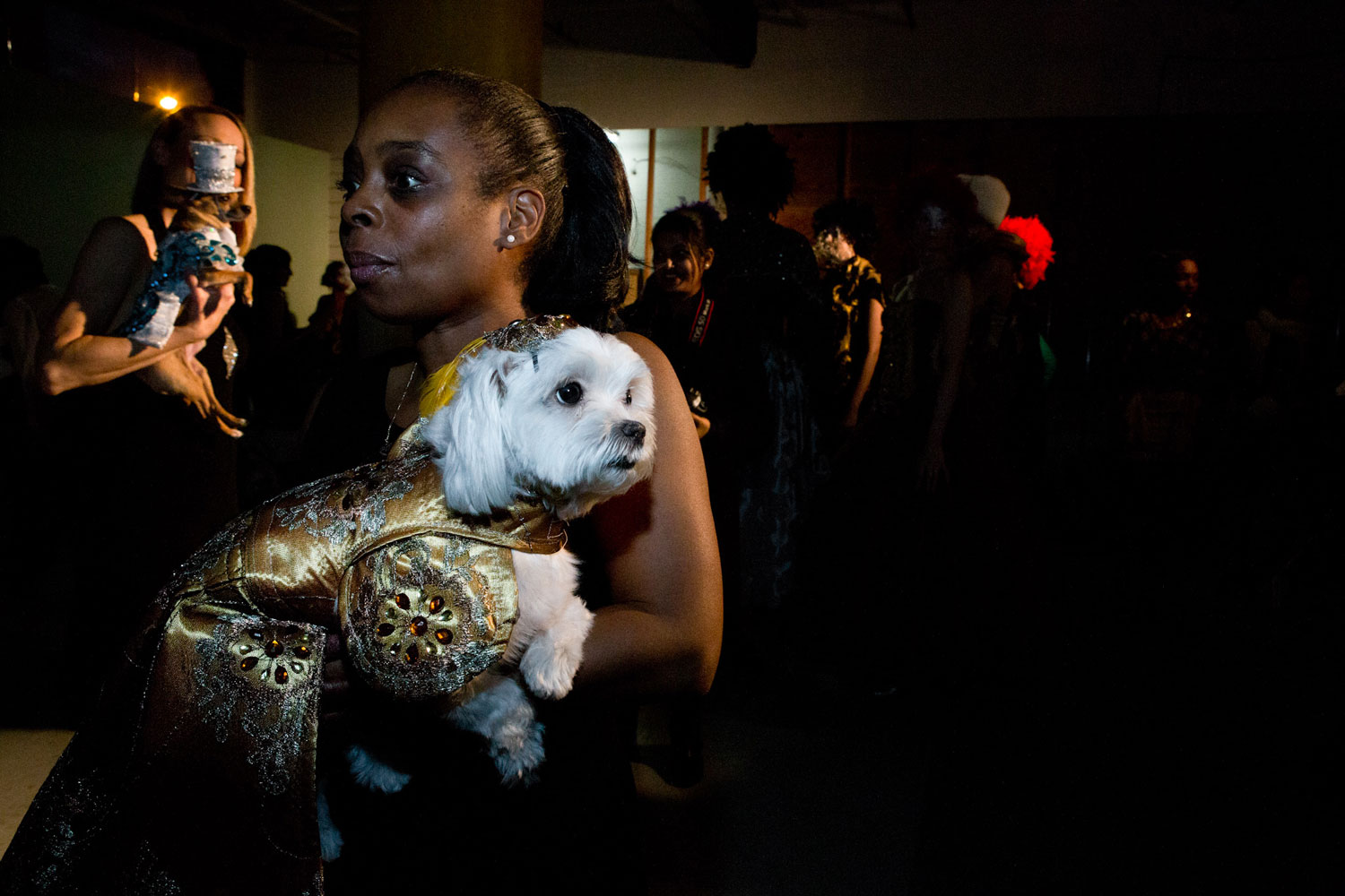 Bobbi Mitchell and her Maltese, Betty Boop, ready to walk the runway at Anthony Rubio's fashion show during Brooklyn Fashion Week.