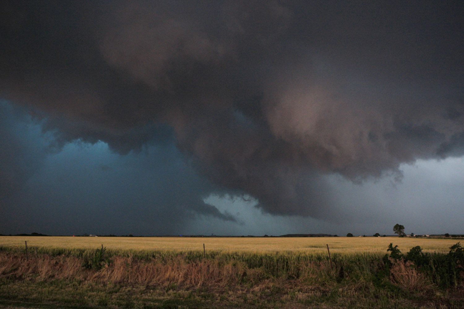 May 31, 2013. Large clouds are seen as a tornado passes south of El Reno, Okla. Violent thunderstorms spawned tornadoes that menaced Oklahoma City and its already hard-hit suburb of Moore on Friday, killing a mother and her baby, and officials worried that drivers stuck on freeways could be trapped in the path of dangerous twisters.