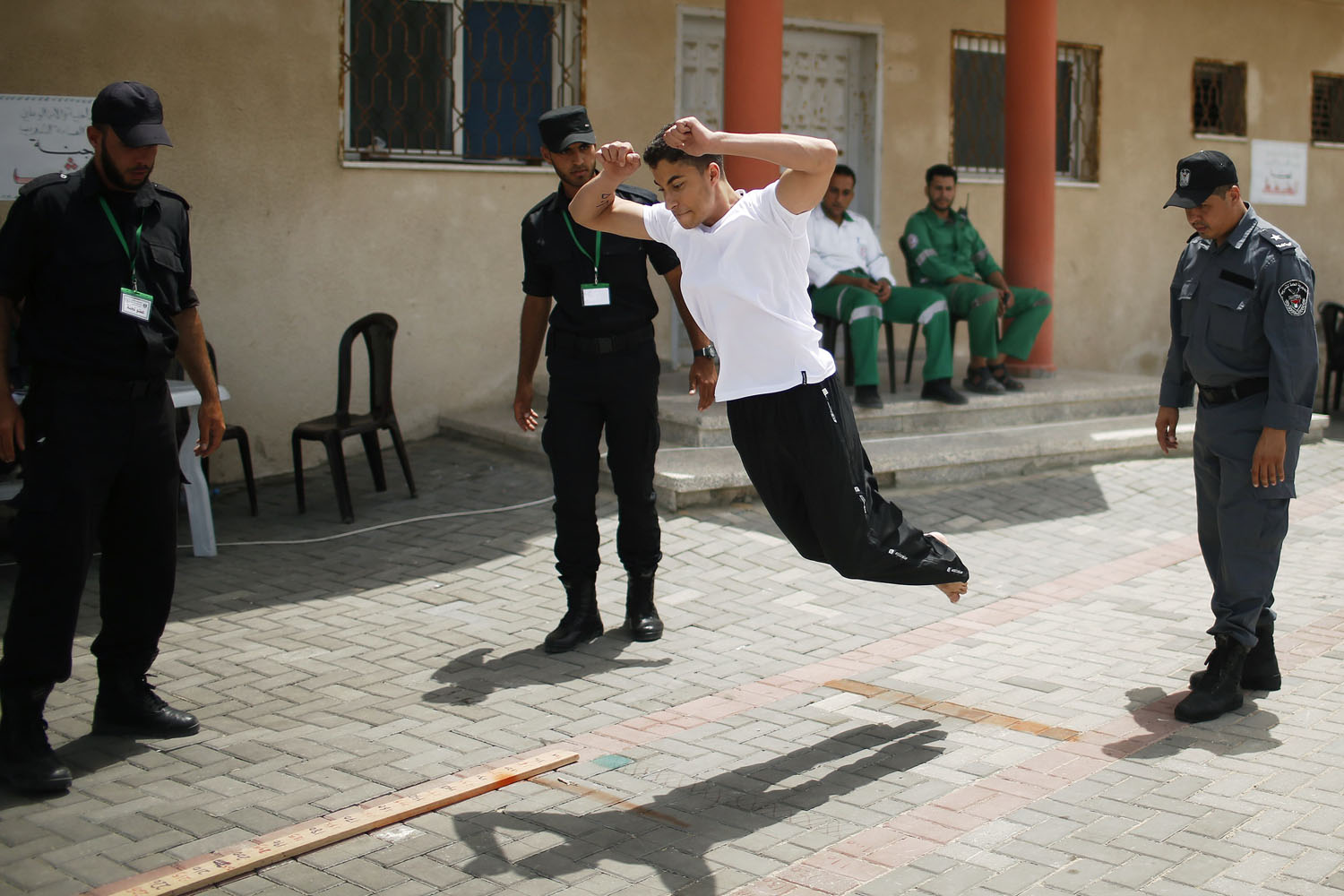 June 3, 2013. A Palestinian applicant undergoes a physical examination at a Hamas recruitment center in Gaza City.